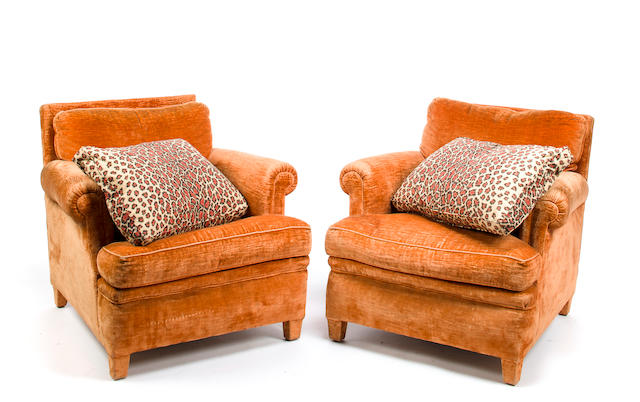 Pair of bergeres, French, mid 20th century, completely upholstered in orange linen velvet, with two animal print pillows by Parish-Hadley, after a design by Elsie de Wolfe, h x w x d: 30 x 33 x 30in. (76.2 x 84 x 76.5cm)