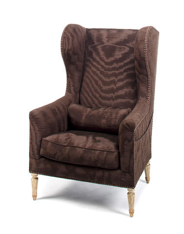 Attributed to Maison Jansen 	Neoclassical style wingback armchair 	mid 20th c.  	painted wood covered in brown watered silk 	h x w x d: 42 x 24 x 18in. (107 x 61 x 46cm)