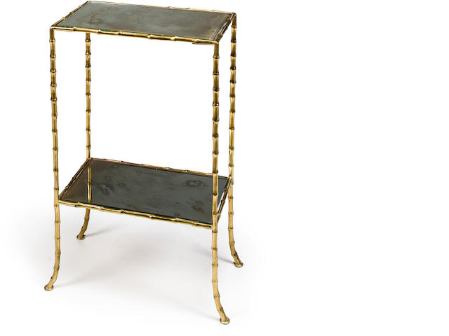 Attributed to Bagues  	two-tiered side table 	third quarterquarter of 20th c. 	gilt metal with mirrored shelves 	h x w x d: 23 x 13.5 x 8in. (58.5 x 34.5 x 20cm)