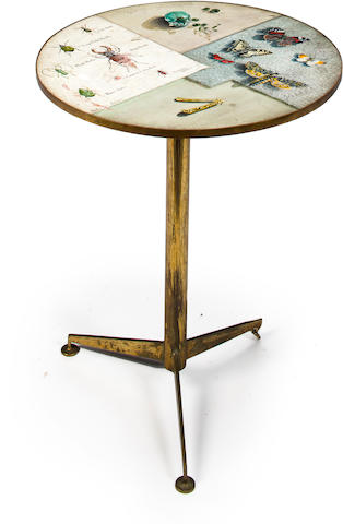 Geoffrey Ghin 	A trompe l'oeil painted occasional table 	Signed and dated 'Geoffrey Ghin fecit 1955' 	Painted wood on gilt metal base 	H 22 ½ (64.5) diam 18 (46cm)