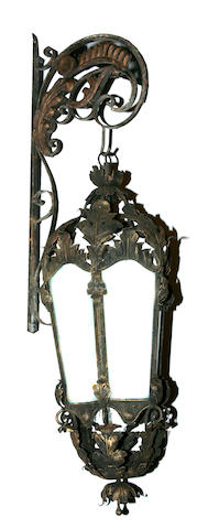 A pair of Rococo style wrought iron and tôle lanterns