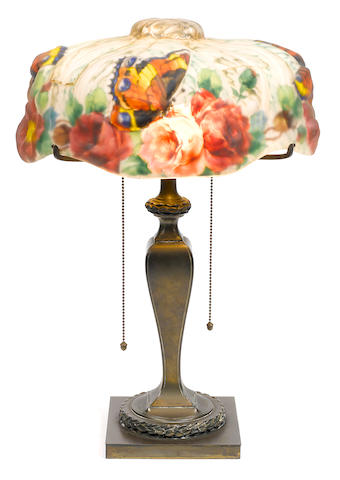A Pairpoint puffy reverse painted glass and patinated metal Butterflies and Roses table lamp first quarter 20th century