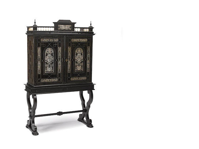 An Italian Baroque style ivory inlaid ebonized cabinet on stand <BR /> cabinet 19th century on later base
