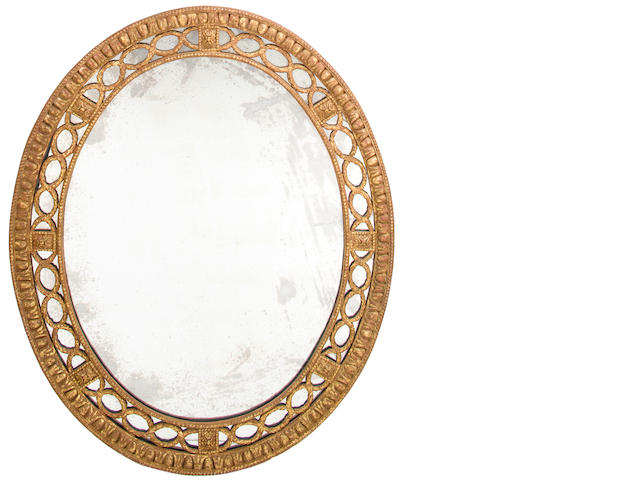 A George III style gilt composition oval mirror<BR />20th century