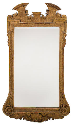 A George II style giltwood and gilt gesso mirror<BR />mid-19th century