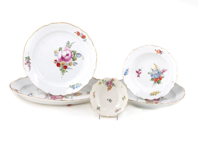 A Royal Vienna glazed porcelain covered bowl and five Meissen porcelain complementary serving platters