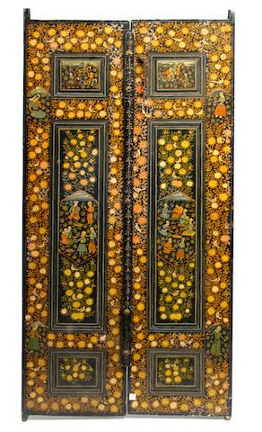 A pair of Persian polychrome wood paneled doors