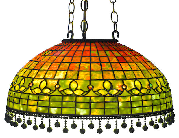 A Tiffany Studios Favrile glass and patinated bronze Trefoil border hanging lamp circa 1910