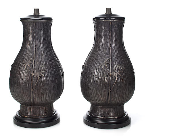 A pair of Japanese patinated bronze Ikebana basket-form vases<BR />late Meiji period, now mounted as table lamps