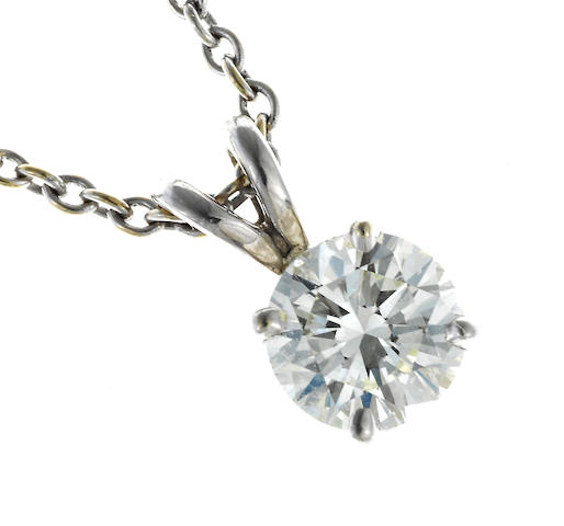 A diamond solitaire pendant with chain