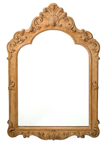 Manner of Jean-Charles Moreaux 	Wall mirror 	1940s 	carved limed oak 	h x w x d: 48 ½ x 32 ½ x 1 3/4in. (123 x 82.5 x 4.5cm)