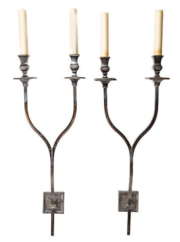 Pair of two-light wall lights 	French, 20th c.  	patinated metal, fitted for electricity 	h x w x d: 27 x 9 ½ x 8 1/2in. (69 x 24 x 21.5cm)