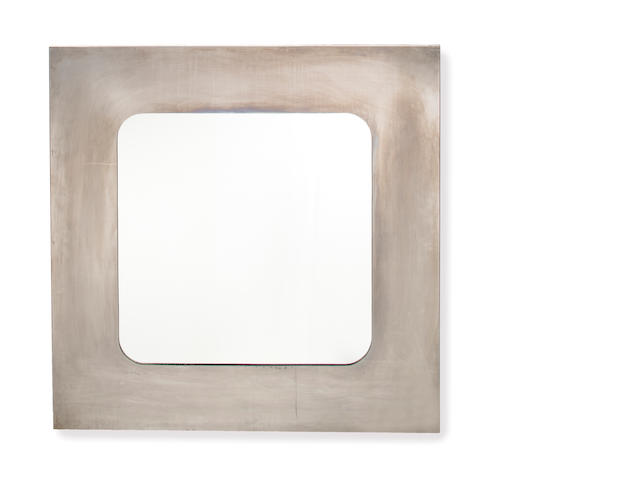 A wall mirror, 1970's Chromed metal, mirrored glass 37 ½in. (95cm) square