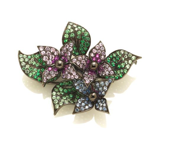 A multi-color sapphire flower brooch, Nafco