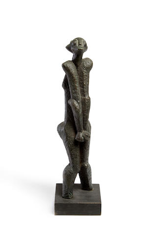 Sydney Alex Kumalo (South African, 1935-1988) Standing woman 43.2 x 11.4 x 11.2cm (17 x 4 1/2 x 4 7/16in).