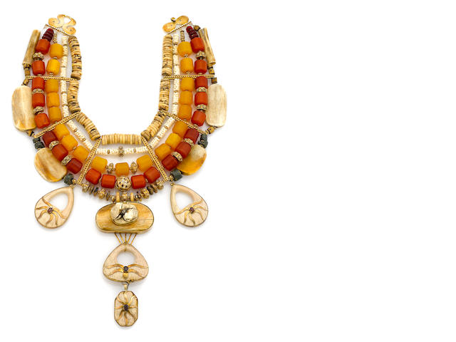 A Tony Duquette date seed, syntetic white coral, copal amber, bone, serpentine, garnet, celluloid and vermeil necklace  'Symbolizes the Diversity of Mankind and Creativity', 1990s