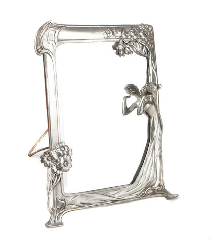 A Continental silvered metal figural mirror