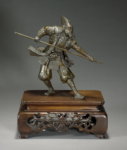 A patinated bronze figure of a warrior Meiji period
