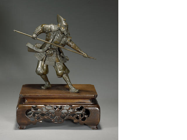 A patinated bronze figure of a warrior<BR />Meiji period