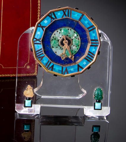 A Cartier carved hardstone desk clock