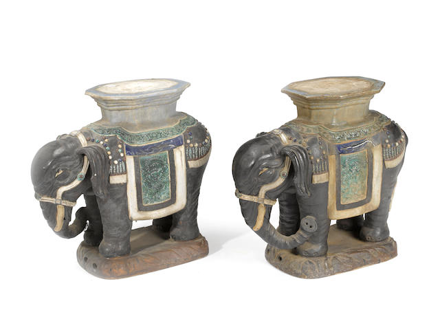 A pair of polychrome glazed earthenware garden seats of elephant form Republic period