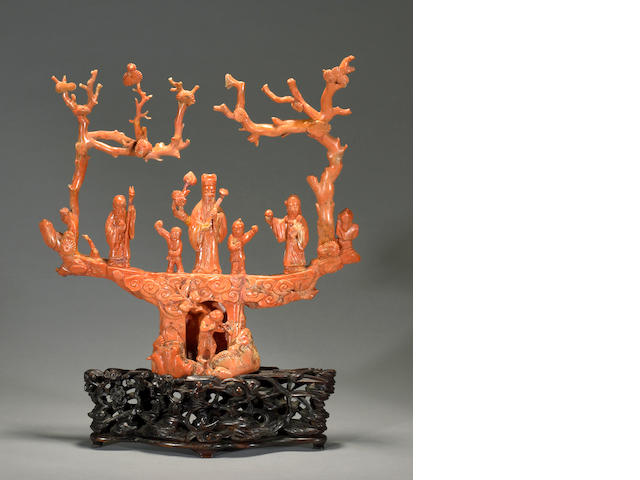 A large carved and pieced coral figural group