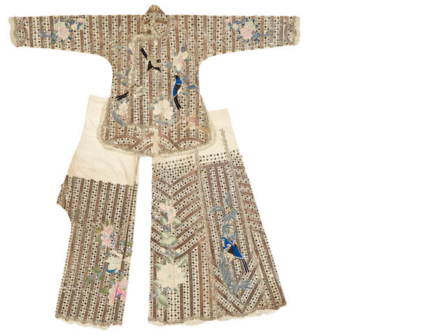 An embroiderd cloth theatrical costume with metal and mirror embellishments Republic period