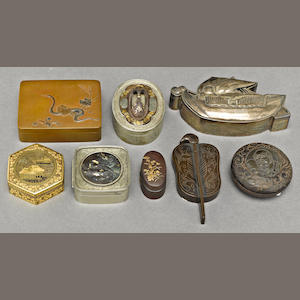 A group of eight small metal boxes. Most Meiji period