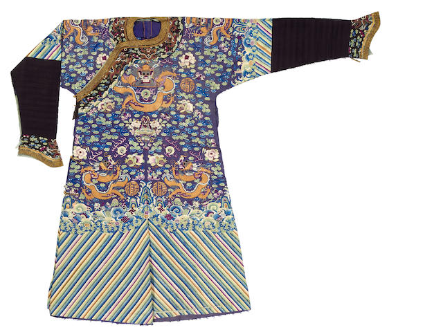 A deep blue silk ground embroidered dragon robe Late Qing dynasty
