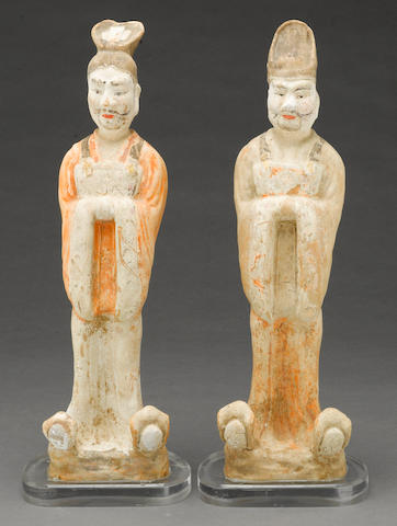 Two painted pottery models of standing officials Tang dynasty