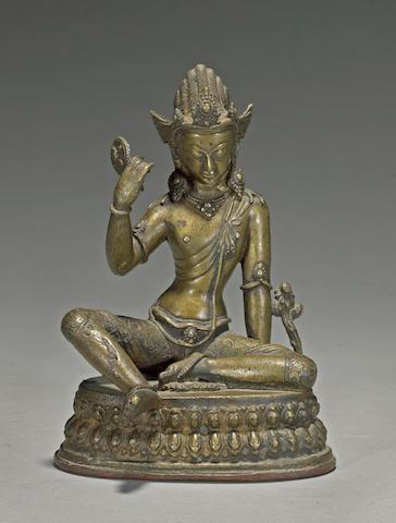 A Himalayan bronze figure of a mahasiddha