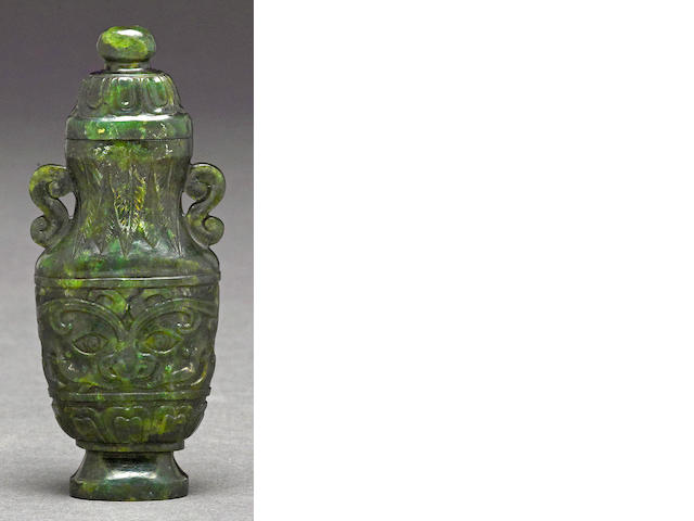 A miniature carved spinach jade covered vase