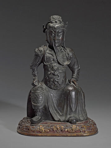 A cast bronze figure of Guan Yu  18th century