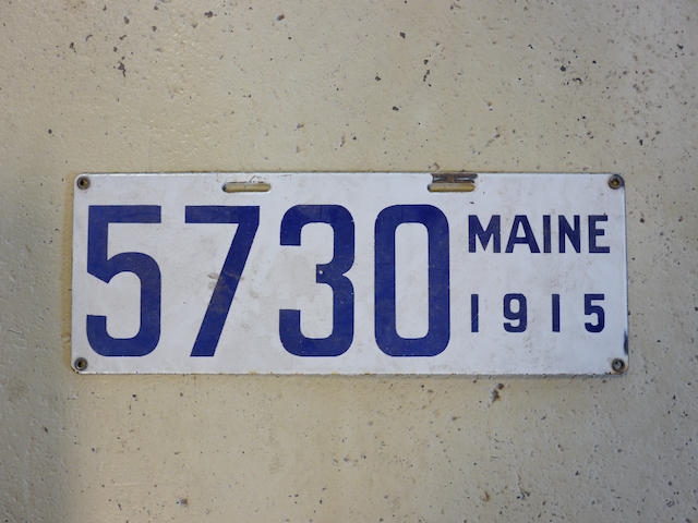 A 1915 porcelain enamel Maine license plate,