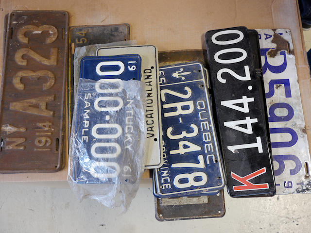 A quantity of mixed interesting license plates,