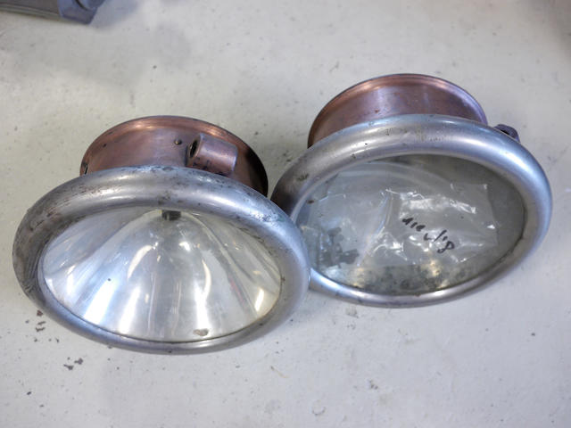 A set of c.1914 brass electric headlamps,