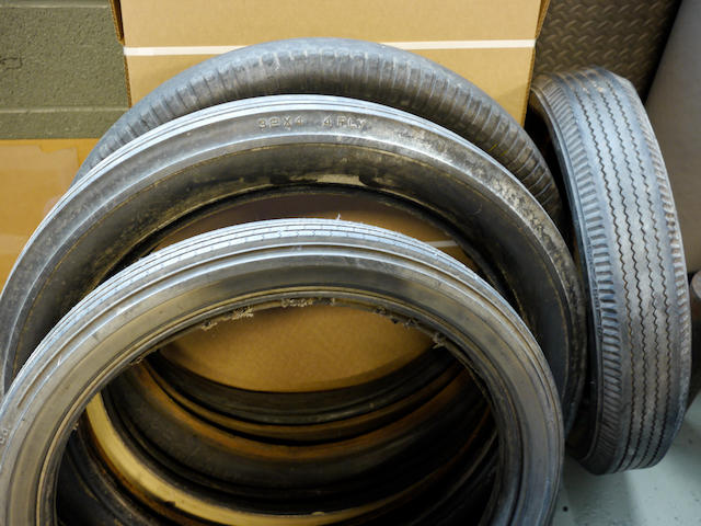 A mixed lot of antique car tires,