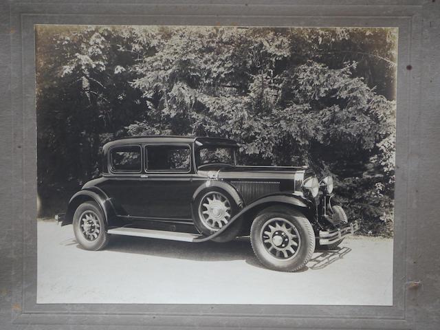 A good, original photo of a 1930 Buick Opera Coupe,