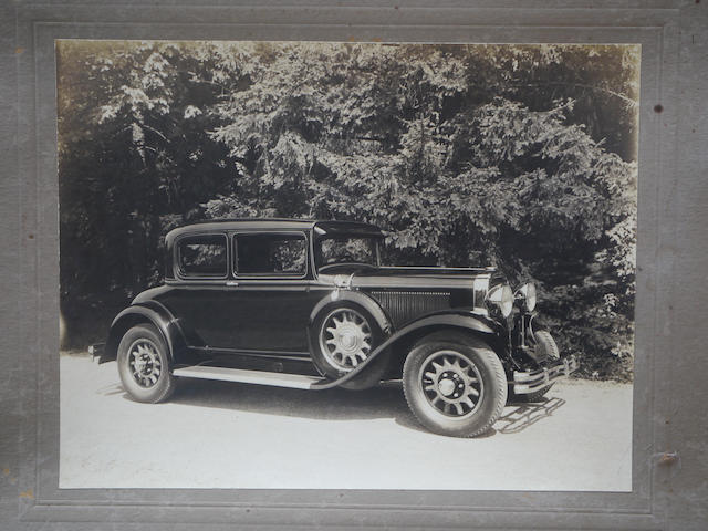 A good, original photo of a 1930 Buick Opera Coupe,