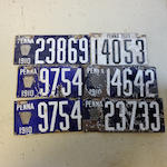 A collection of 1910 Pennsylvania porcelain enamel license plates,