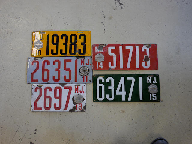 A selection of various early year New Jersey porcelain enamel license plates,