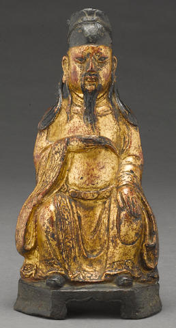 A polychrome lacqeured bronze seated Daoist divinity Late Ming dynasty