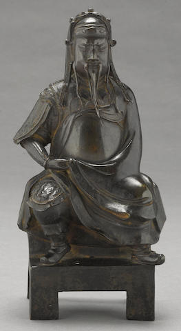 A cast bronze seated Daoist divinity 18th/19th century