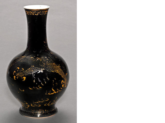 A mirror black glazed porcelain vase with gilt decoration 19th century