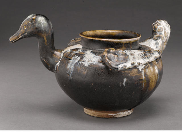 An unusual bird-shaped stoneware jar with suffused brown glaze Tang dynasty