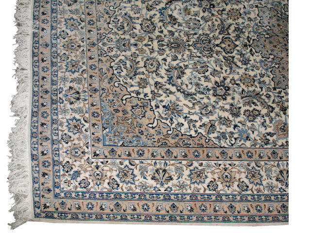 A Nain carpet size approximately 7ft. 2in. x 11ft.