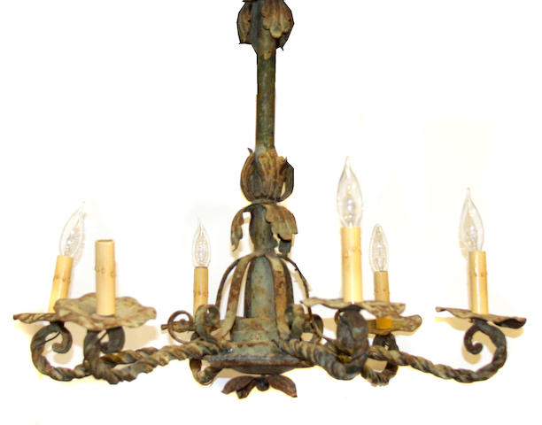A paint decorated wrought iron chandelier