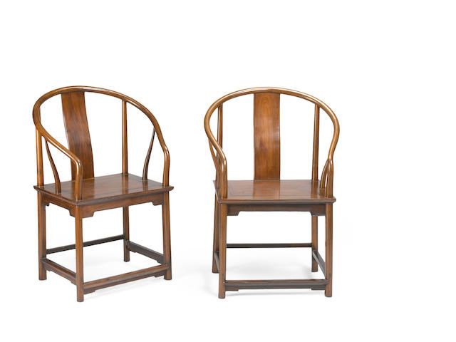 A pair of hardwood continuous horseshoe back arm chairs 20th century