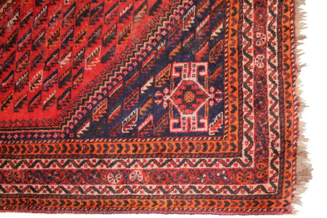 A Southwest Persian carpet  size approximately 7ft. x 10ft.