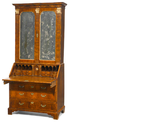 A George II parcel gilt walnut mirrored bureau bookcase
